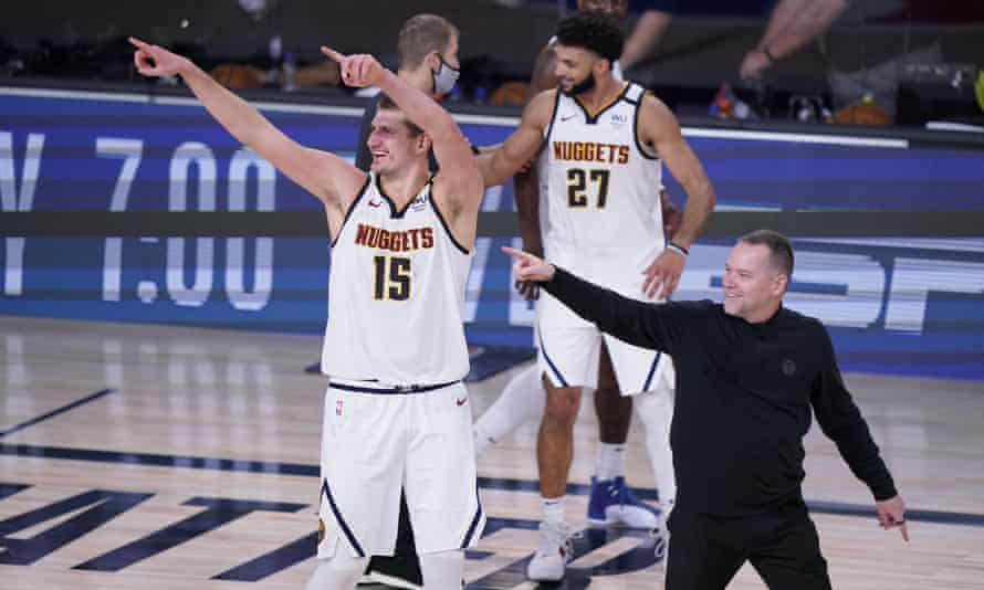 Nikola Jokic  and Denver Nuggets head coach Michael Malone celebrate their NBA playoff victory over the Los Angeles Clippers