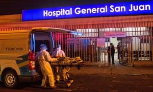 Paramedics carry a woman into the emergency area of the San Juan de Dios Hospital in Guatemala City.
