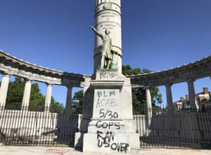 A monument to Confederate President Jefferson Davis in Richmond covered with graffiti on Sunday, May 31, 2020, after overnight protests.