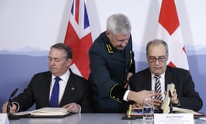Liam Fox signs a trade deal with Switzerland.