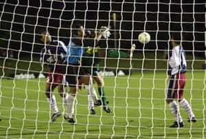 Archie Thompson of the Socceroos gets a goal past Nicky Salapu of American S?moa during the Oceania group one World Cup qualifier match in 2001