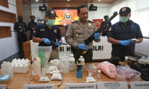 Police spokesman Rikwanto with weapons and bomb-making materials seized this week.