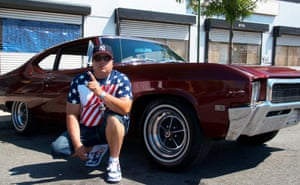 Calvin Guzman from Pennsylvania, a participant in the classic car parade with his Skylar 1968 Buick