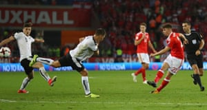 Ben Woodburn thumps home a wonderful strike to give Wales the lead.