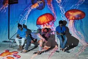 A group of friends relaxing on a joali fathi, a typical Maldivian hammock