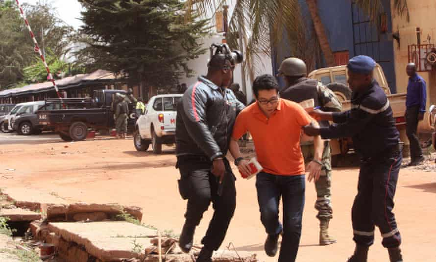 Hostage leaving the Radisson Blu
