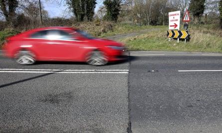 A Motorist travel across the Irish border near the town of Middletown, Northern Ireland.
