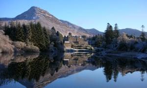 Reflected glory: Ballynahinch Castle overlooking its lake with the Twelve Bens mountain range behind.