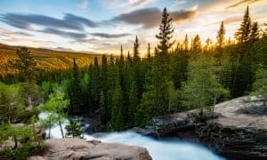 The sun rises over Alberta Falls, Colorado