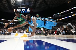 Texas, USJulian Wright dives for a ball against Larry Sanders during the BIG3 basketball league