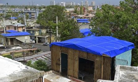 Fema tarps on homes in San Juan, Puerto Rico on 19 October 2017.