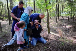 <strong>Roszke, Hungary</strong> A father is arrested by local police on the Hungarian-Serbian border after he tried to take his family across the border from Serbia into the EU.
