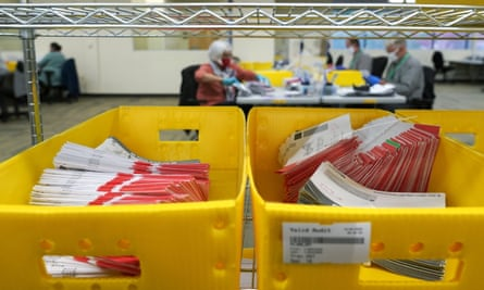 Boxes of vote-by-mail ballot envelopes await processing at the King county election headquarters in Renton, Washington.