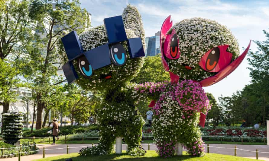 Shrubs formed into topiary shapes representing Tokyo Olympic mascot Miraitowa, left, and Para-Olympic mascot Someity in Ariake Park.
