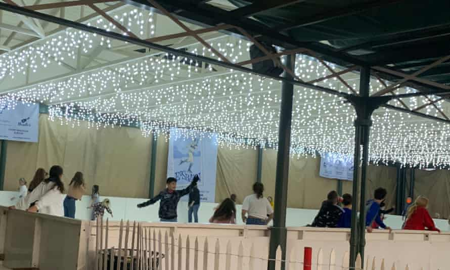 Children skate on a makeshift ice rink in the small Christmas village of Fredericksburg, Texas.