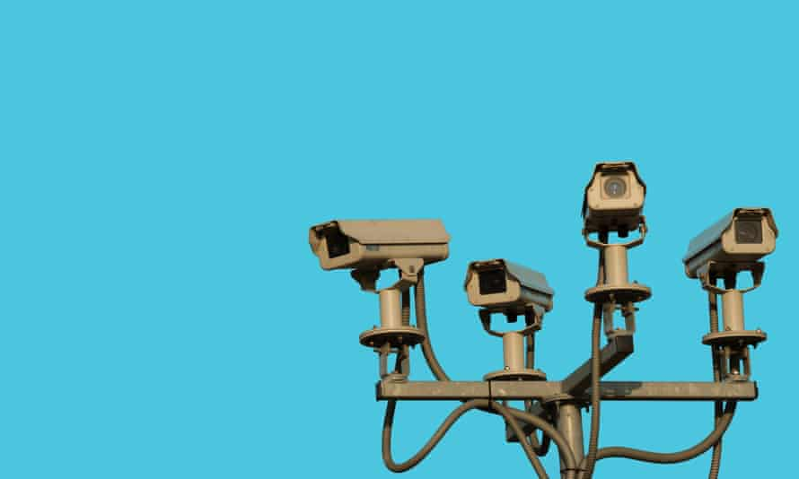 Four CCTV cameras on a cyan field