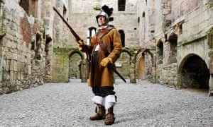 This is England 1643: Thomas dressed as a member of Sir William Pennyman's Regiment, with helmet, musket, big boots.