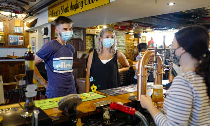 Sophie and Garrie from Tunbridge Wells, first customers to order from the bar at the Chainlocker pub in Falmouth on 19 July