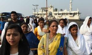Indian women leave after visiting the inner sanctum of the Haji Ali Dargah in Mumbai.