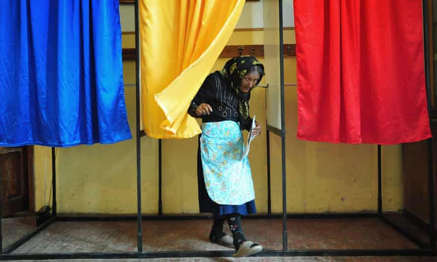 An Romanian woman leaves the voting cabin in the 2009 European elections.