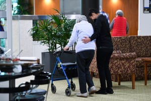 An aged care worker helps a resident at the Goodwin Aged Care facility in Canberra.