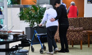 An aged care worker helps a resident at the Goodwin Aged Care facility in Canberra, June 20, 2018.