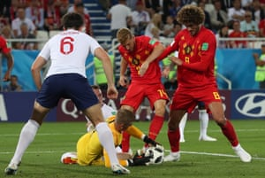 d313f21ced2 Marouane Fellaini and Dries Mertens of Belgium in action against goalkeeper  Jordan Pickford (down)