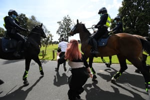Police try to intercept protesters during an anti-lockdown demonstration in Melbourne on Saturday.