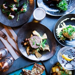 Selection of food, photographed from above, at The Cow, Dalbury Lees, UK.