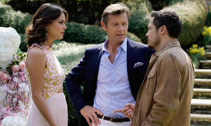 Nathalie Kelley as Cristal Flores , Grant Show as Blake Carrington and Rafael de la Fuente as Sam Flores in the rebooted Dynasty on Netflix.