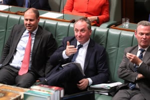 Deputy PM Barnaby Joyce gestures to photographers during question time