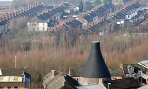 A renovated former pottery chimney stands against a backdrop of terraced housing in Stoke-on-Trent