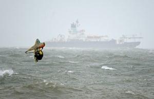 Kite surfer enjoys the waves at Preston beach in Weymouth