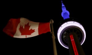 Toronto's CN Tower is lit up in blue, white and red