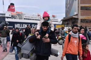 Refugees arrive at the port of Piraeus following their arrival from the island of Lesbos on Wednesday.
