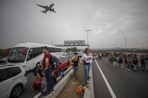 Protesters block the roads leading to El Prat airport on the outskirts of Barcelona.