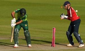 Fakhar Zaman of Pakistan is bowled by Moeen Al as England wicketkeeper Jonny Bairstow looks on.