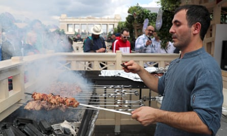 man grilling shish kebabs at Shashlik Live festival in Moscow's Gorky Park