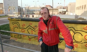Haring with his Berlin Wall mural in 1986.