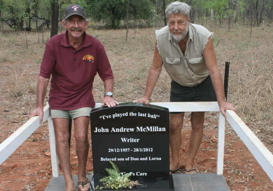Paddy Moriarty and Barry Sharpe at the grave of writer Andrew McMillan at a little bush cemetery in Larrimah.