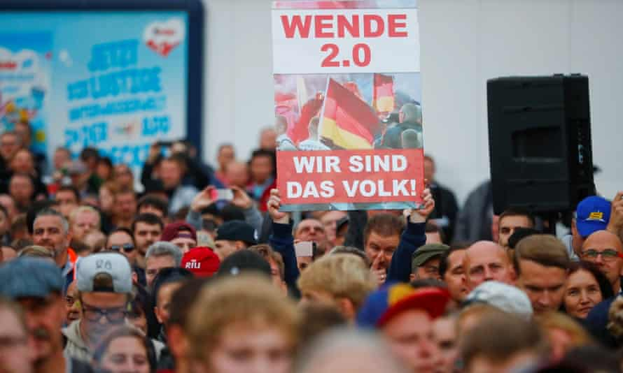 """A banner reads """"We are the people"""" at a protest in Chemnitz."""