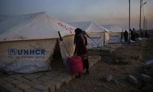A Syrian woman newly displaced by the Turkish military operation in Syria at a camp in Iraq
