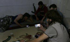 Rebel fighters in Aleppo follow news about Donald Trump's election as US president.