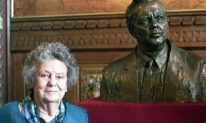 Mary Wilson by a bronze bust of her husband at the time of its unveiling in the House of Commons in 2001.