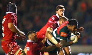 Manu Tuilagi, seen here dragging Scarlets' Gareth Davies and Hadleigh Parkes along the Welford Road turf, was back to his best on Friday night.