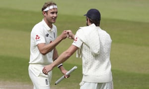 Stuart Broad celebrates with Chris Woakes, who took five wickets on the final day to lead England to a series-clinching victory against West Indies.