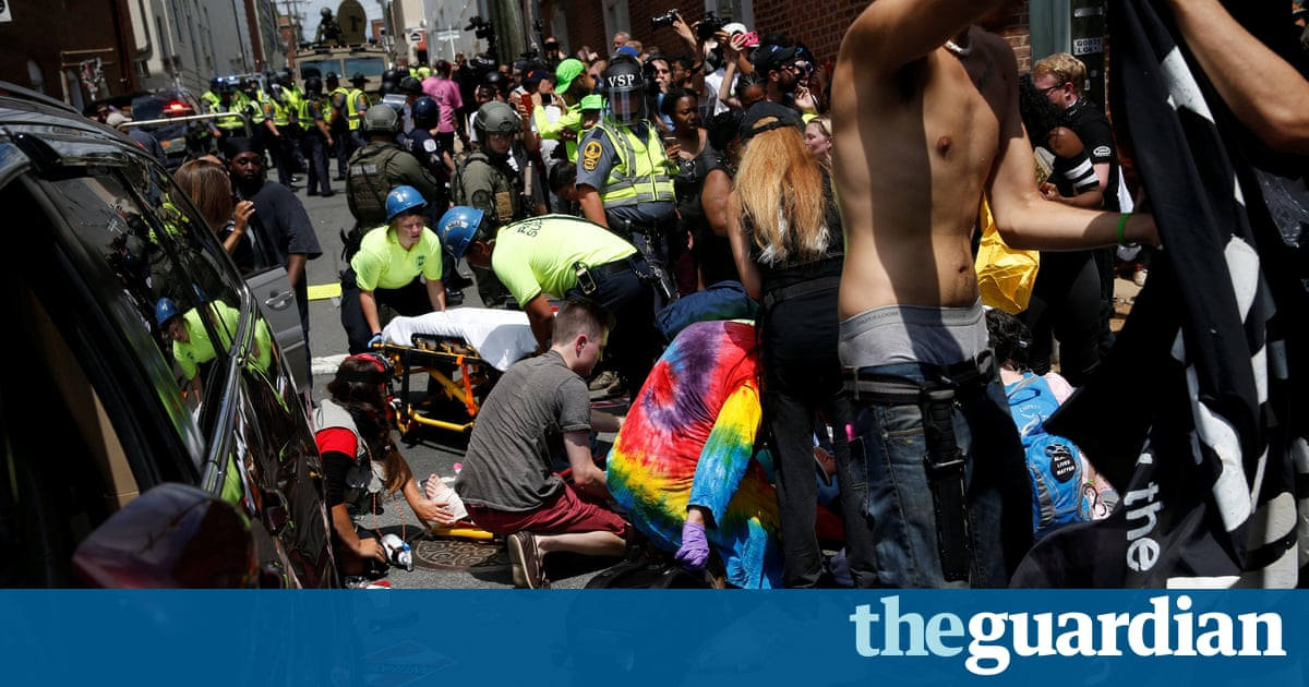 Charlottesville: man charged with murder after car rams anti-far-right protesters