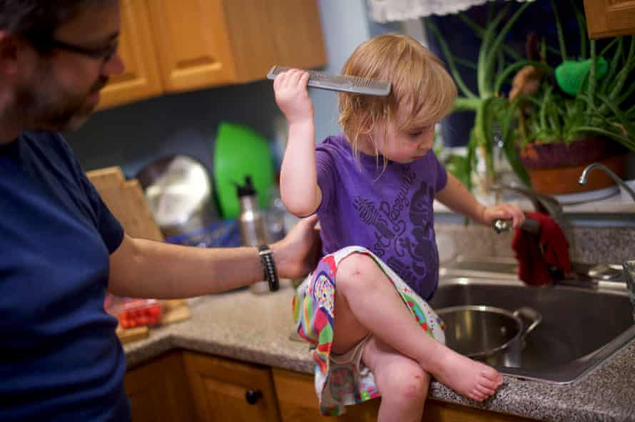 Elsa O'Malley, three, combs her hair after wetting it with tap water. Katy O'Malley, 39, mother of two, and their family drink tap water, and she recently was concerned enough to have to city water department come out and test.