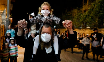 Ultra-Orthodox Jews in Israel, here celebrating Lag BaOmer on 11 May, have been less stressed by the pandemic than their non-religious neighbours.