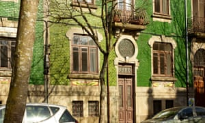Street view of the green-tiled house.